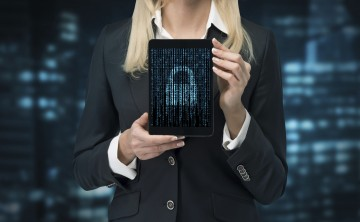 businesswoman holding touch pad with lock