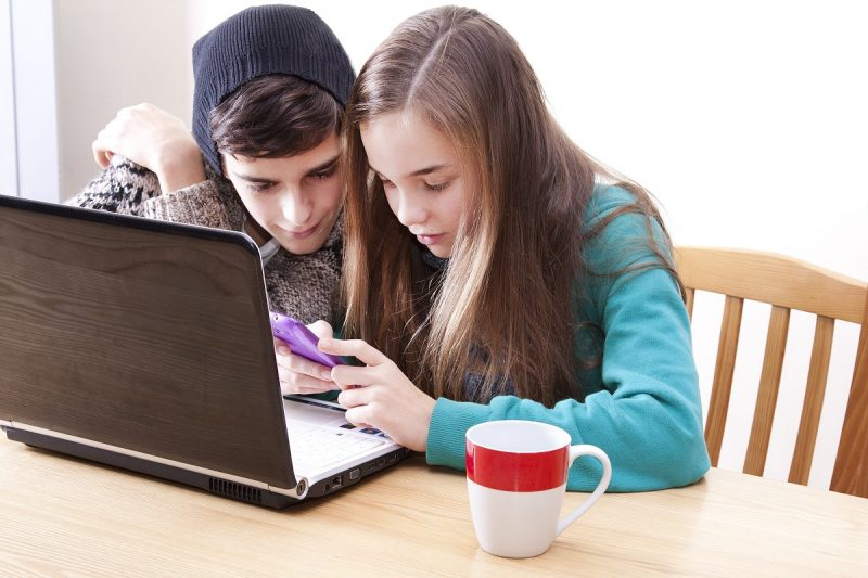 Two young people on a phone