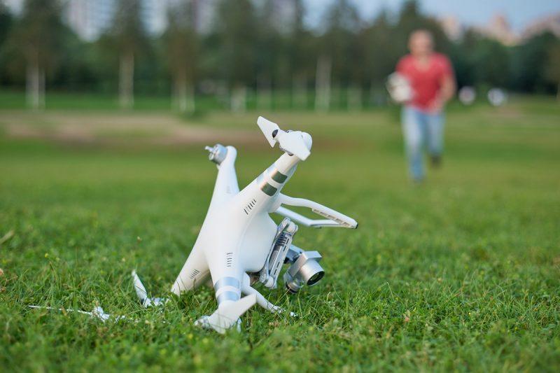 A drone sat on it's side in a field