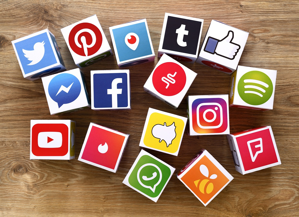 social media cubes on wooden desk