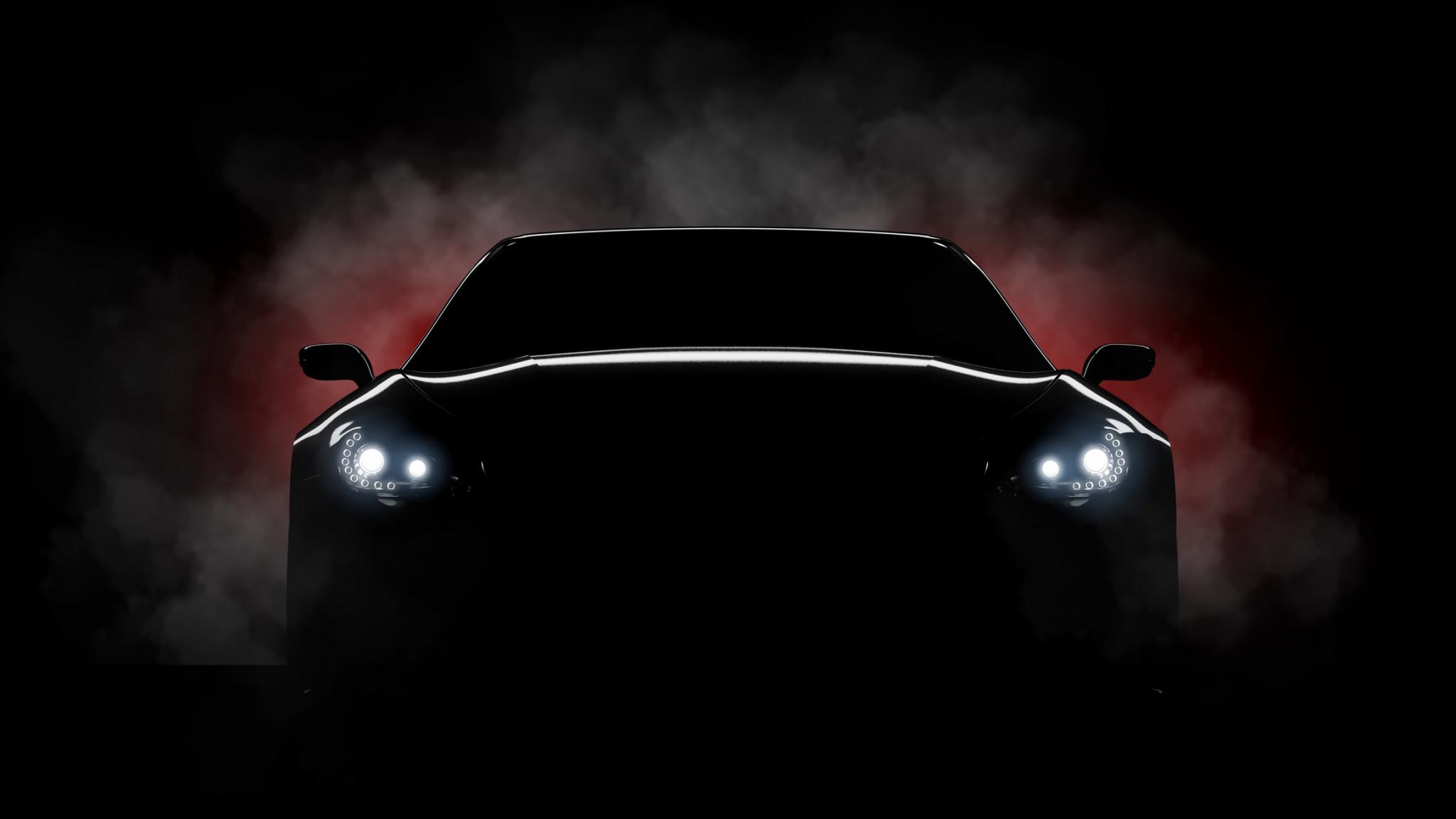 car headlights against dark background