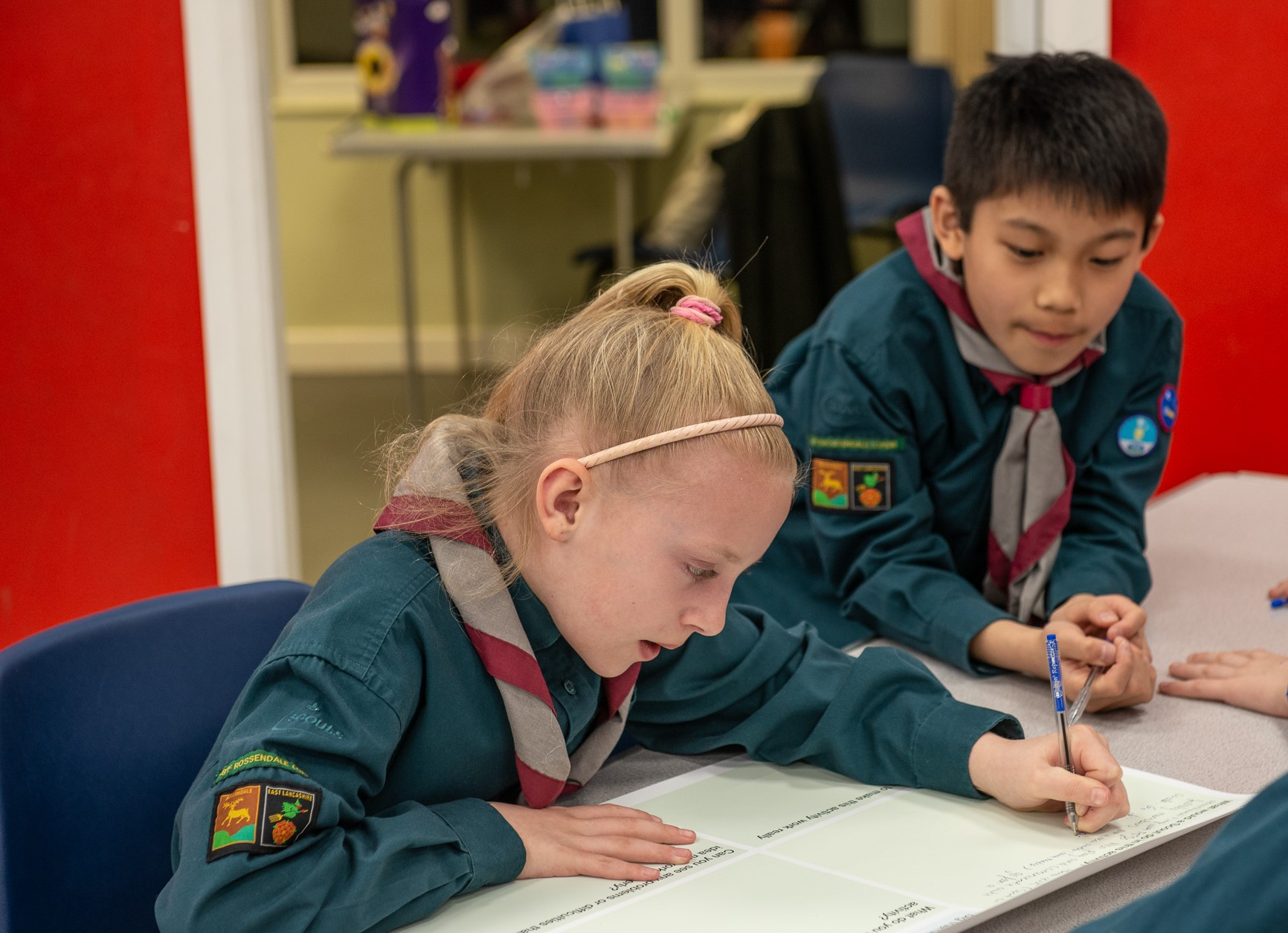 scouts working on a badge