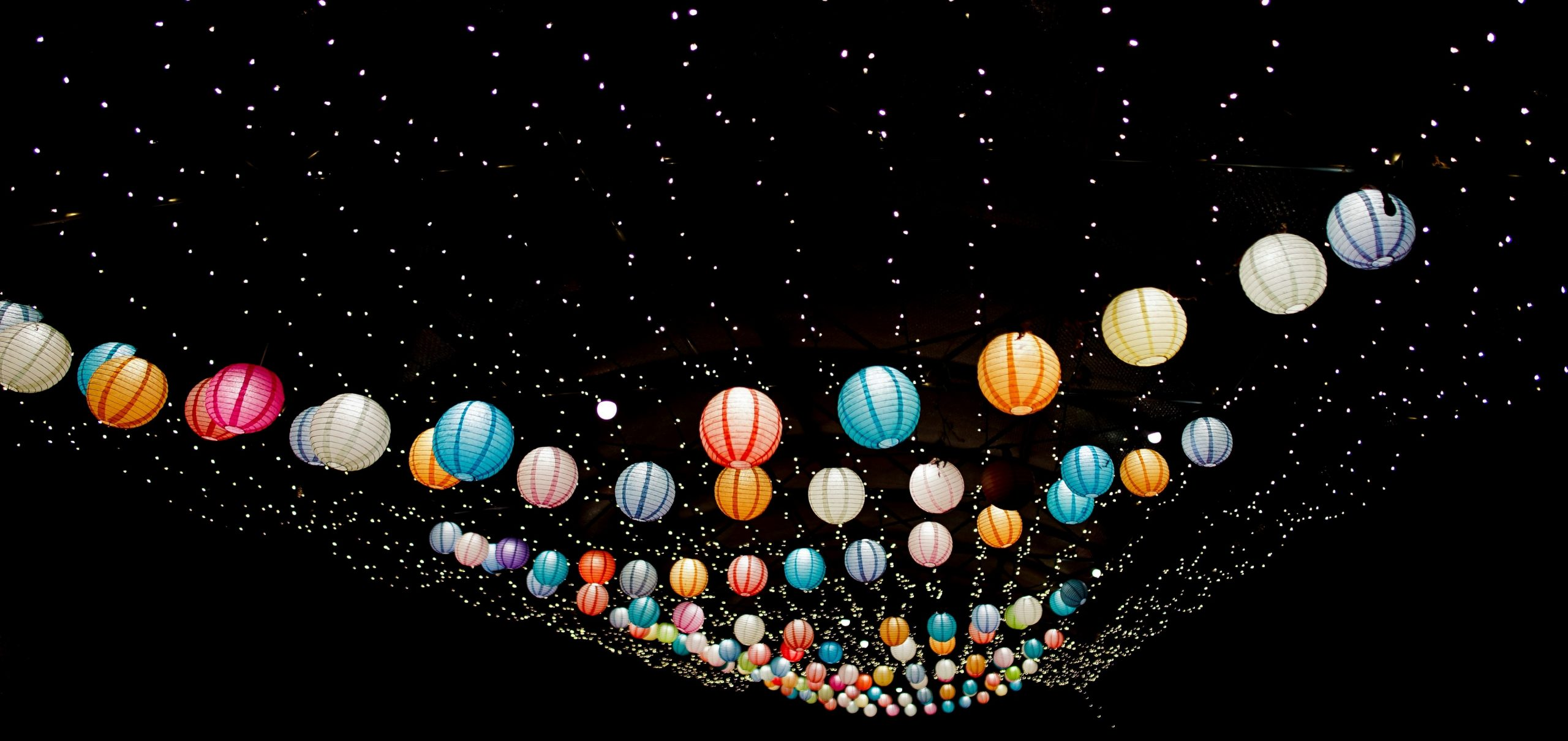 coloured lanterns in a dark sky