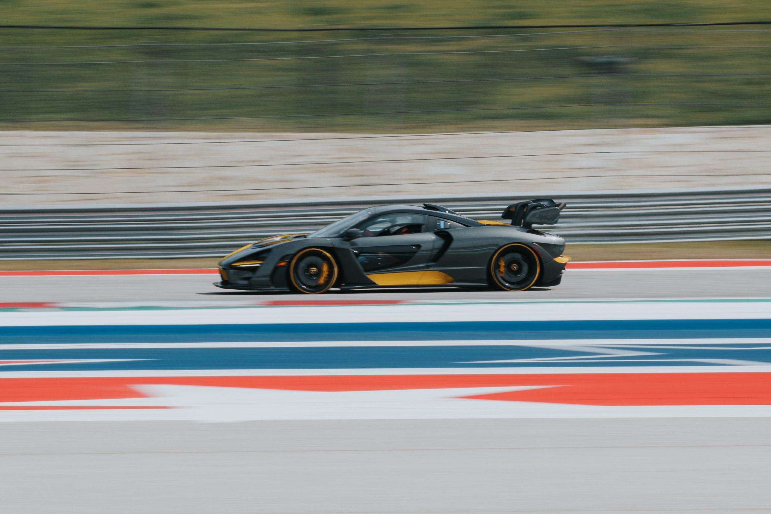 fast car speeding around a track